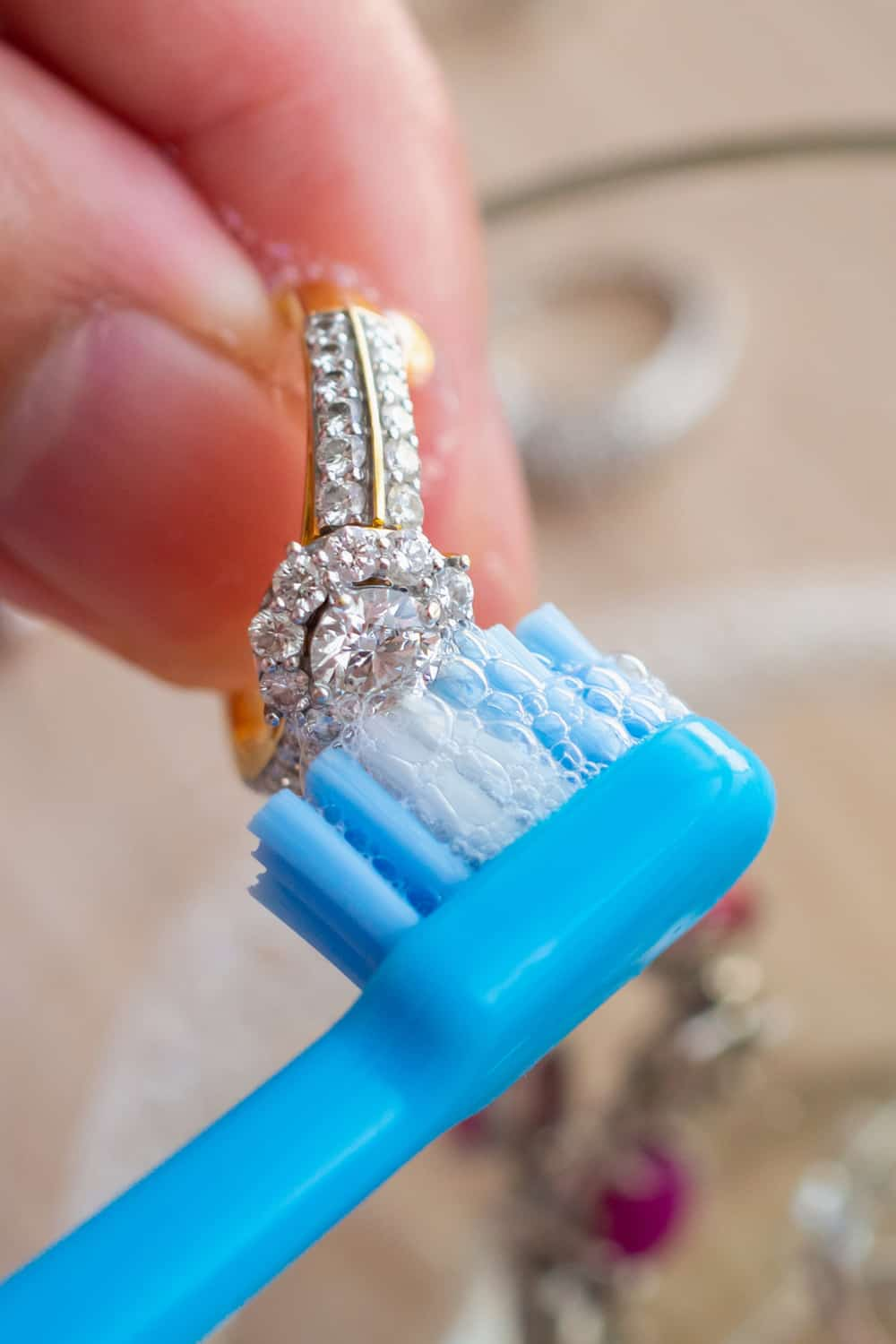 Clean your white gold rings using soap and baking powder