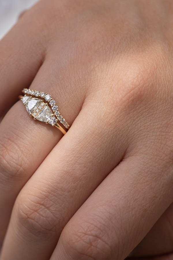 If your engagement ring is extravagant go for a simpler wedding band and vice-versa