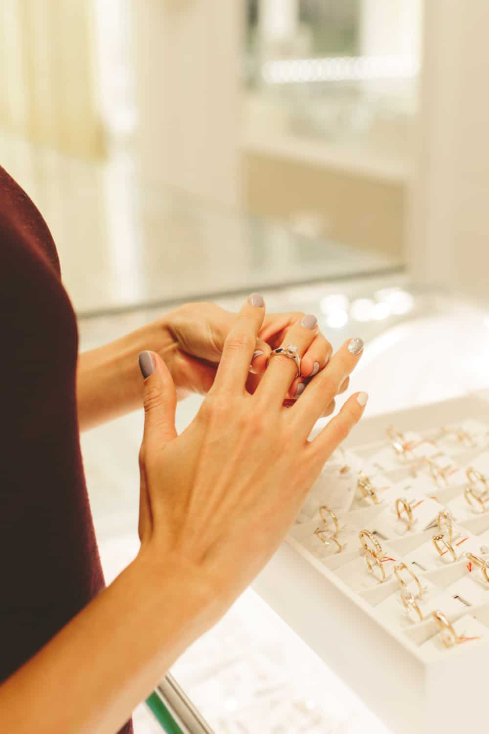 What factor should you consider before deciding on who buys the wedding rings