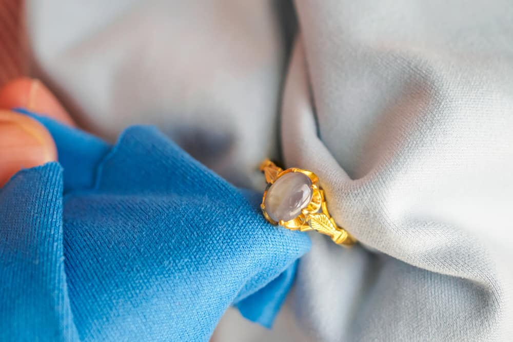 Cleaning Jewelry which includes Glued-In Gemstone